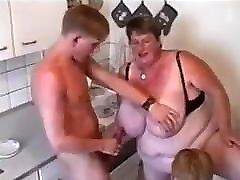 Grandma plays with her big breasts and her sons