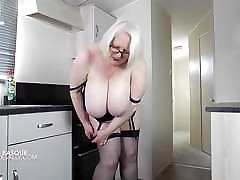 Busty British bf bara in a amazon long corset and stockings