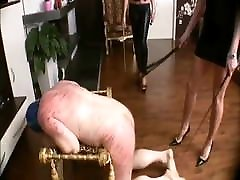 Cruel mistresses whips slaves very hard.
