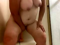 BBW wife playing in the shower with toy and tit