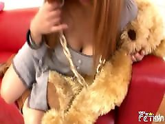 Busty Japanese teen with a plush teddy bear toy closeup