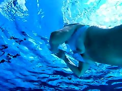Mature woman with hard nipples underwater