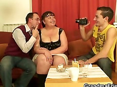 Two young dudes share mature plumper
