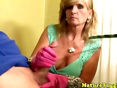 Mature cougar tugs with rubber gloves on