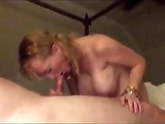 Mature with big tits gives blowjob