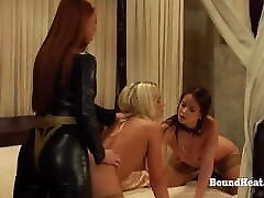 Deep Strapon Penetration in BDSM Lesbian Threesome with