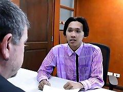 Asian twink barebacked by older male in office