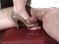 Babe uses her high heels to play with this dude's cock and the floor
