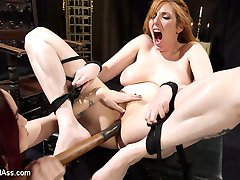 Mistress Bella Rossi has redhead bombshell Lauren Phillips bound and at her mercy. Lauren begs...