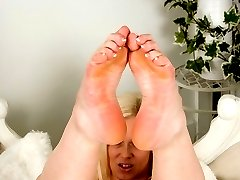 Anna likes the attention of showing off her perfectly formed tiny feet!