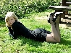 Beautiful Laura is outside and showing off her nylon stockings and high heels