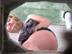 Bikini babes pissing in a spycammed beach toilet
