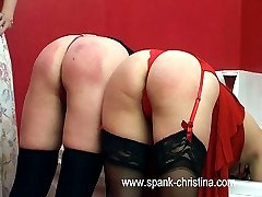 Two voluptuous bare bottoms caned in the bathroom - deep tramlines and hot welts