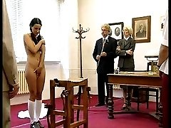 Pretty girl restrained over a desk and relentlessly caned to tears on her exposed naked bottom