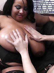 Happy client gets lucky with an oiled up black BBW masseuse in sexy lingerie