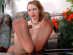 Awesome chick in reinforced toes pantyhose going crazy from footsy games