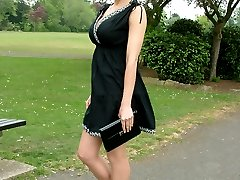 Hot Milf Monica posing in a gorgeous short black dress with matching shiny high heels