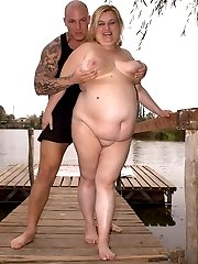 Hot bbw Cynthia pushes her tits together as she rides a huge cock by the lake