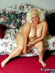 Busty mature BBW lounges about naked