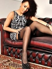 Kayla-Louise takes off her short dress to reveal her stockings, suspenders and silk lingerie