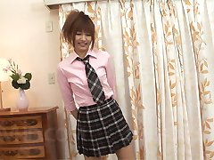 Kotone Aisaki Asian in school uniform rubs erect dick of her palm