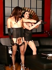 Sexy dominatrix Anastasia Pierce prepares her male slave by grooming him and punishing him with her cane