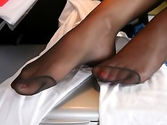 Fair-haired gal posing in her control top hose while teasing with her feet