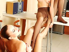 Sapphic gals in control top hose enjoy foot licking and fondling at a cafe