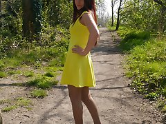 Hot Milf Jenna is wearing a beautiful yellow dress with a pair of sexy silk nylons and tall...