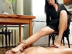 Annas slave is lying at her feet and shes trying to finish her work with the computer. She...