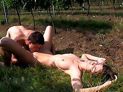The vineyard is a quiet and secluded spot for these two lovers. Hidden by the grape plants, they race to take each others clothes off and satisfy each others sexual desires.