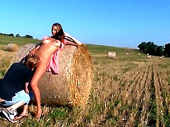 This hay bale is their bed today. Underneath the warm sun feels so natural for these horny teen...