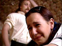 Tearful girl tied over a bench for bare assed caning - biting strokes - swollen cheeks