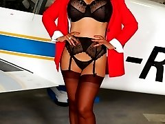 Air hostess Danica in stockings and heels