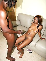 Redhead ebony slut gets licked and fucked by a monster black dong