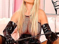 Latex blonde showing her boobs