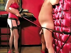 Domina trains her bound male slave whipping his dick and trampling his nuts