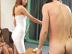 Guy with ponytail doing nails to charming babes