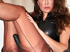 Strap On Dildo Jane slips in to a passionate pair of nylon stocking and a bit of leather to go with her big black strapon,  before her virgins come over for a bang