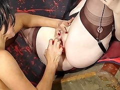 Strap On Dildo Jane leans this busty lesbian red-haired over and fucks her pussy with a big red strapon