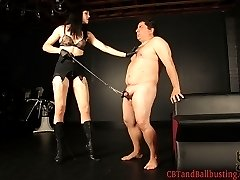 We couldn't be more excited that after 4 years Mistress O returns to CBTandBallbusting.  Mistress O is strikingly beautiful and quietly confident.  She is also highly skilled in impact play such as floggers and paddles, which she shows us in this video.  Mistress O leads her slave in by his balls, bends him over a spanking horse and lays into him with heavy floggers, bare handed spanking, and a leather paddle.  She also uses a wartenberg wheel to provide a little extra stimulation, to keep her slave on edge.