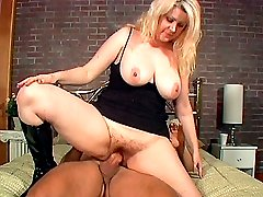 Plump blonde with hairy pussy banged on top
