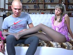 Long-legged babe uses her slender pantyhose clad feet for nylon fetish sex
