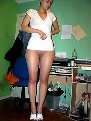 Young housewife in shiny panyhose on the bed