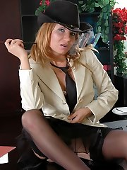 Tempting gal in lace-top nylons and lush corset getting horny on the table