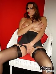Goregeous Cougar Nylon Jane teases her yam-sized juicy tits in sexy nylons, lingerie and high heels