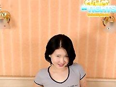 Miniature Asian hooker posing in seductive tights