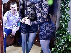 Dark-haired slut in a provoking dress and blue tights gets impaled on a rod