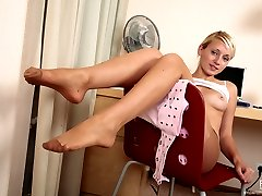 Vivacious chick in toe reinforced pantyhose using her feet in various ways