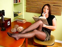 Sweltering black-haired tongue-polishing her pedicured feet in black pantyhose